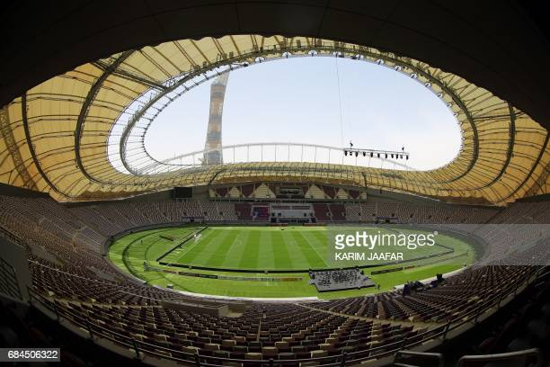 Picture taken with a fisheye lens on May 18 shows a general view of the Khalifa International Stadium in Doha after it was refurbished ahead of the...