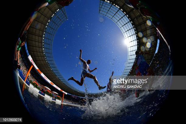 TOPSHOT Picture taken with a fisheye lens shows athletes competing in the men's 3000m steeplechase event during the European Athletics Championships...