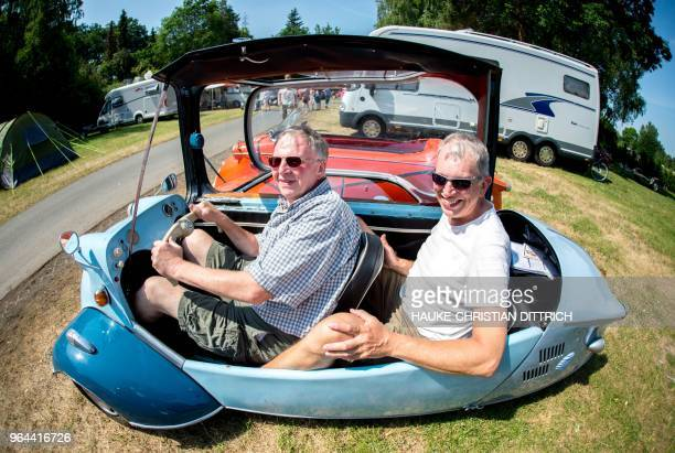 Picture taken with a fisheye lens shows the brothers David and Ryalwin Garner from the region around Liverpool posing inside their 'Messerschmitt...