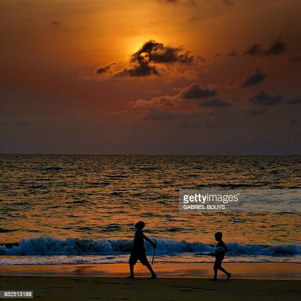 A picture taken with a mobile phone shows two children playing along a beach in Libreville on the sidelines of the 2017 Africa Cup of Nations...