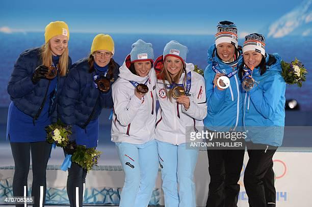 A picture taken with a robotic camera shows Finland's silver medalists AinoKaisa Saarinen and Kerttu Niskanen Norway's gold medalists Ingvild...