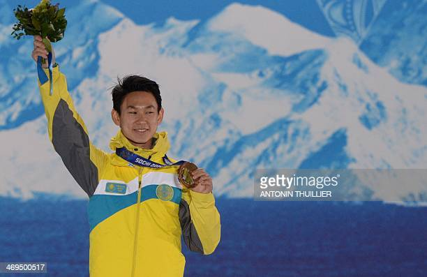 A picture taken with a robotic camera shows Kazakhstan's bronze medalist Denis Ten posing on the podium during the Men's Figure Skating Medal...