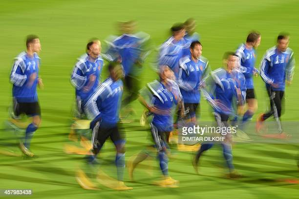 A picture taken with a slow shutter speed shows Basel's players warming up during a training session at the Vassil Levski stadium in Sofia on October...