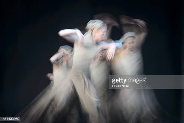 A picture taken with a slow shutter speed shows members of the English National Ballet perform 'Dust' choreographed by Akram Khan from 'Lest We...