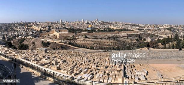 TOPSHOT A picture taken with a smartphone using panoramic mode on December 1 2017 shows a view of Jerusalem from the Mount of Olives US President...
