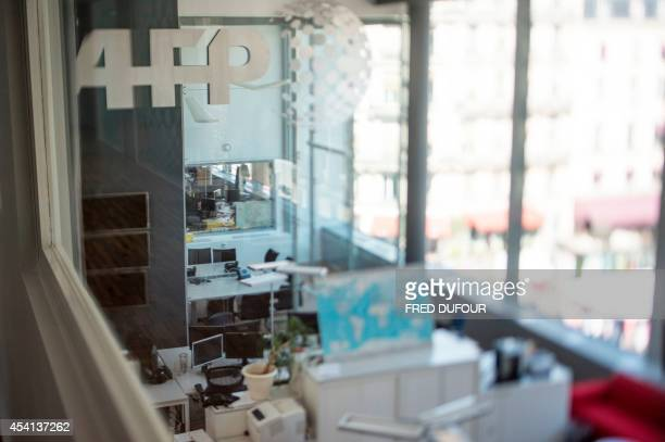 A picture taken with a tilt and shift lens on August 22 2014 shows offices at the headquaters of the international news agency Agence FrancePresse in...