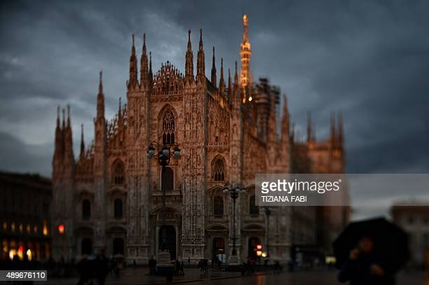 A picture taken with a tilt and shift lens shows Milan's cathedral at sunset during the women Spring / Summer 2016 Fashion Week on September 23 2015...