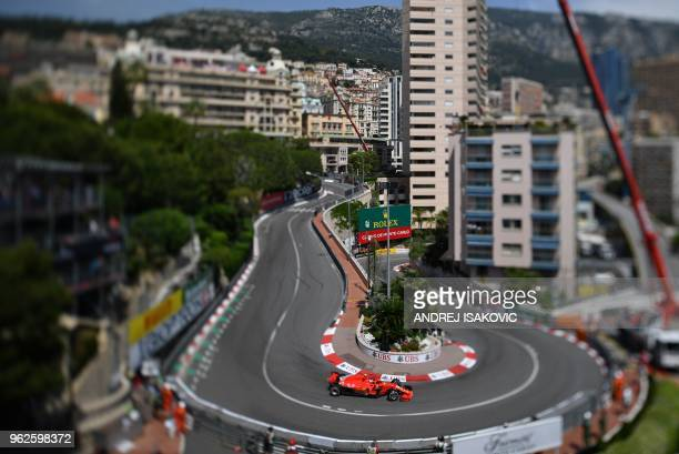 Picture taken with a tilt-shift lens shows Ferrari's Finnish driver Kimi Raikkonen driving during the third practice session at the Monaco street...