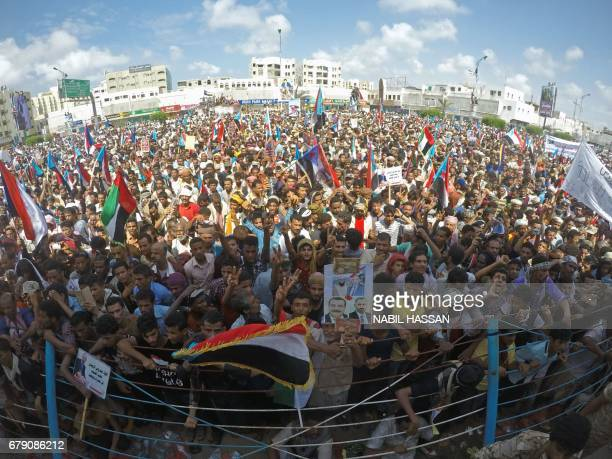 A picture taken with a wideangle lens on May 4 2017 shows Yemenis waving flags of the southern separatist movement during a demonstration in the...