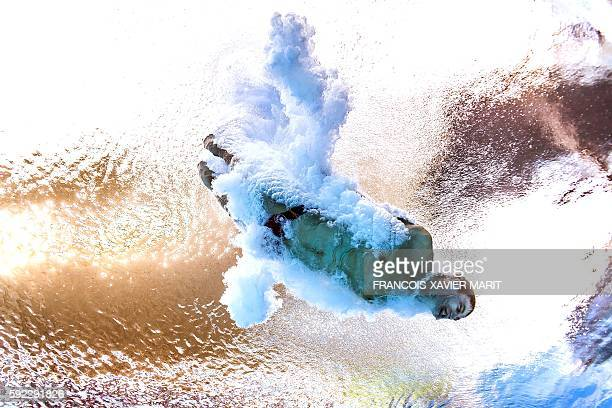 A picture taken with an underwater camera shows Canada's Vincent Riendeau competing in the Men's 10m Platform Semifinal during the diving event at...
