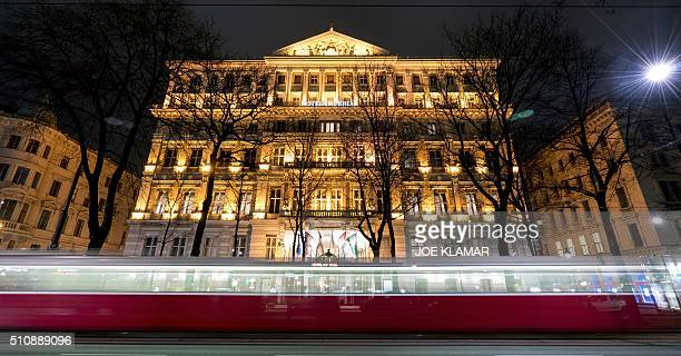 A picture taken with long exposure shows a tram driving past the Hotel Imperial in Vienna on February 17 2016 The 138room Hotel Imperial in Vienna...