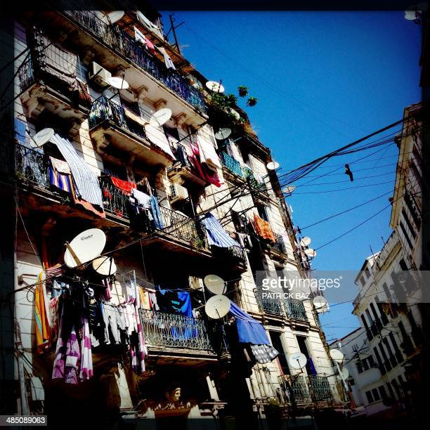 A picture taken with the Hipstamatic application shows laundry hanging on the balconies in the centre of the Algerian capital Algiers on April 16...