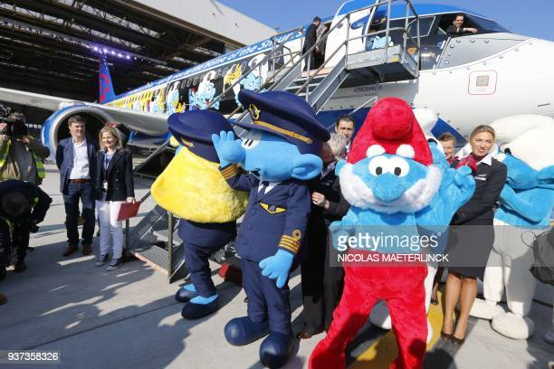 A picture takenon March 24 2018 shows the presentation of the Smurfs aircraft of Brussels Airlines at Brussels Airport in Zaventem / AFP PHOTO /...