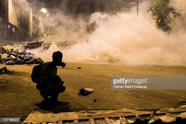 Picture was taken on the road up to taksim in Istanbul while police go after protesters at . Tear gas attack is in progress.