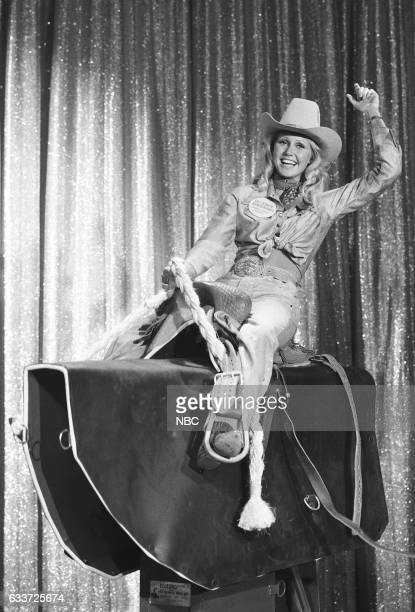 1973 Miss Rodeo America Pam Earnhardt riding mechanical bull on August 29th 1975