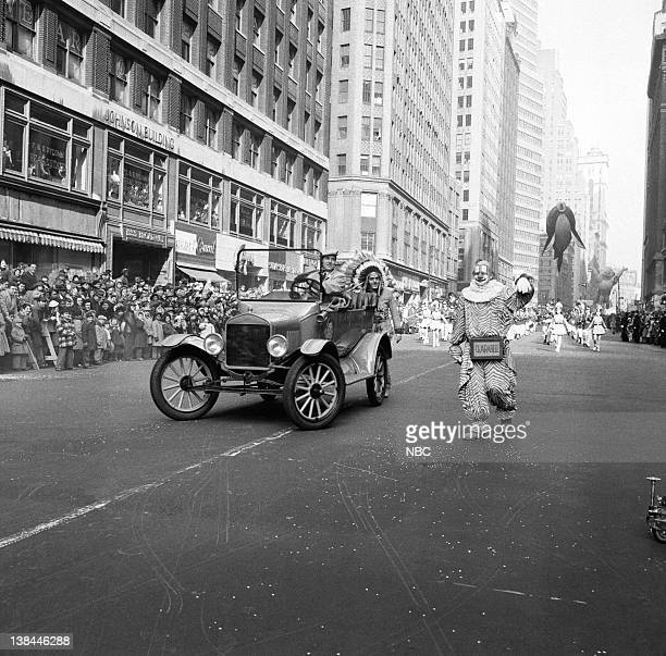 A car drives by with some of the cast members of Howdy Doody during the 1954 Macy's Thanksgiving Day Parade