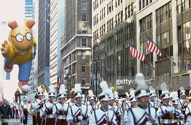 A marching band followed by Arthur balloon during the 2000 Macy's Thanksgiving Day Parade
