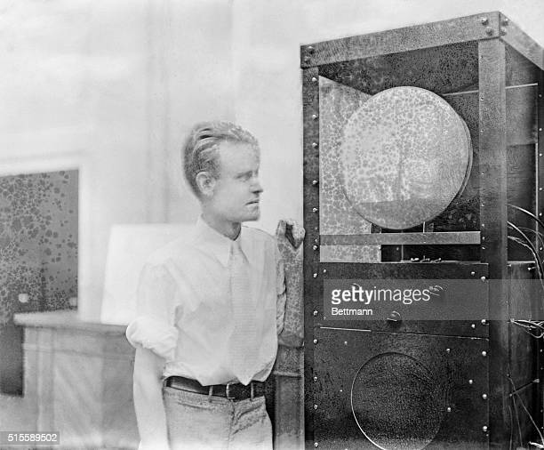 Pictured above is Philo Farnsworth 27yearold inventor of a television set as he watched a televised picture of Joan Crawford as it appeared on the...