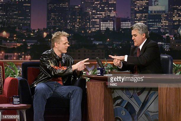 Actor Christopher Titus plays a game of rock paper scissors during an interview with host Jay Leno on December 11 2000