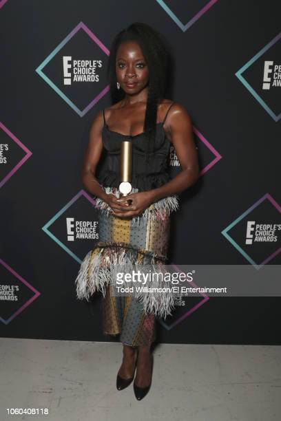 Actor Danai Gurira winner of The Action Movie Star of 2018 award for 'Black Panther' poses backstage during the 2018 E People's Choice Awards held at...