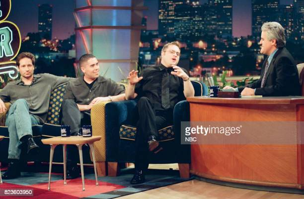 Actor David Duchovny and musical group Barenaked Ladies during an interview with host Jay Leno on February 26 1999