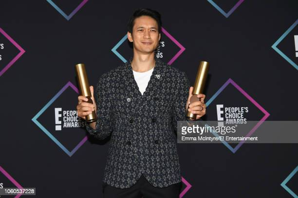 Actor Harry Shum Jr winner of The Male TV Star of 2018 award and The Show of 2018 for 'Shadowhunters' poses in the press room during the 2018 E...