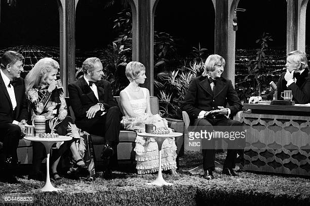 Actor John Wayne actress AnnMargret Harvey Korman actress Sandy Duncan actor Christopher Mitchum during an interview with host Johnny Carson on June...