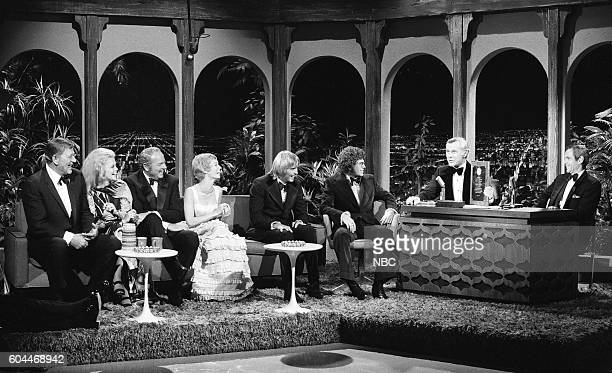 Actor John Wayne actress AnnMargret Harvey Korman actress Sandy Duncan actor Christopher Mitchum actor Gary Grimes during an interview with host...