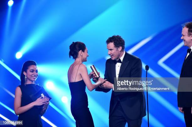 Actor Mila Kunis accepts The Comedy Movie of 2018 award for 'The Spy Who Dumped Me' from actors Will Ferrell and John C Reilly on stage during the...