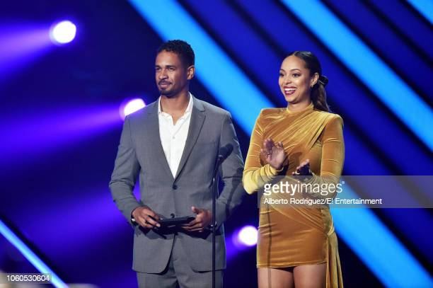Actors Damon Wayans Jr and Amber Stevens West speak on stage during the 2018 E People's Choice Awards held at the Barker Hangar on November 11 2018...