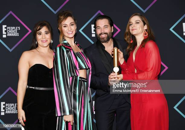 Actors Emily Andras Katherine Barrell Tim Rozon and Melanie Scrofano pose in the press room during the 2018 E People's Choice Awards held at the...