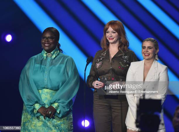 Actors Retta Christina Hendricks and Mae Whitman speak on stage during the 2018 E People's Choice Awards held at the Barker Hangar on November 11...