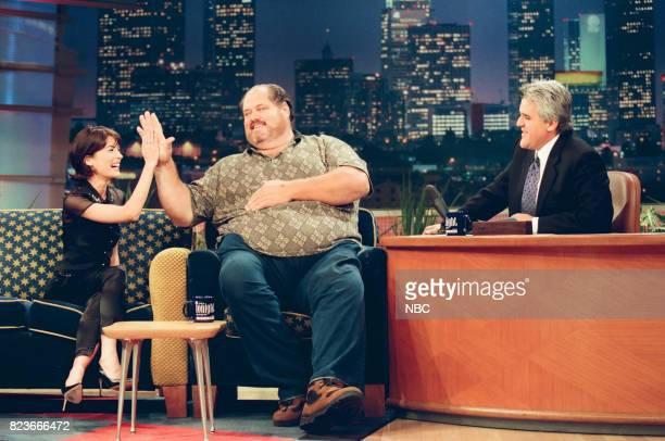 Actress Lara Flynn Boyle and arm wrestling champion Cleve Dean during an interview with host Jay Leno on March 1 1999