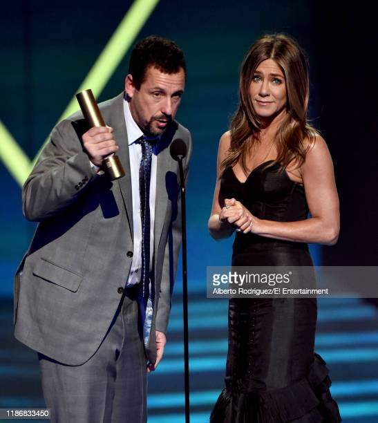 Adam Sandler and Jennifer Aniston accept The Comedy Movie of 2019 award for 'Murder Mystery' on stage during the 2019 E People's Choice Awards held...