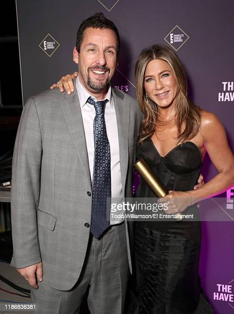 Adam Sandler and Jennifer Aniston pose backstage during the 2019 E People's Choice Awards held at the Barker Hangar on November 10 2019 NUP_188991