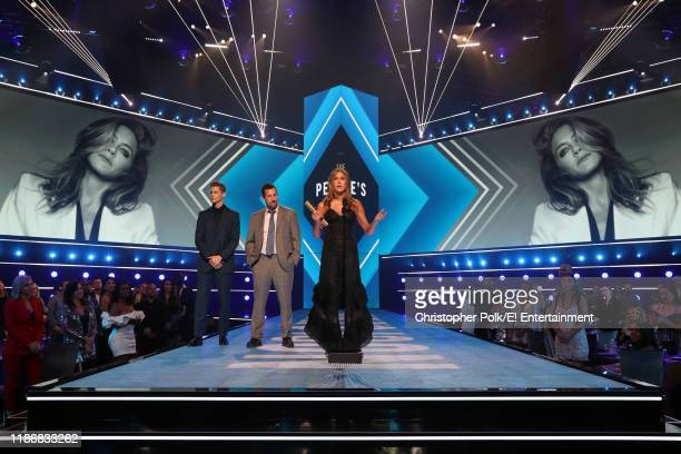 Adam Sandler and Jennifer Aniston winner of the People's Icon award on stage during the 2019 E People's Choice Awards held at the Barker Hangar on...