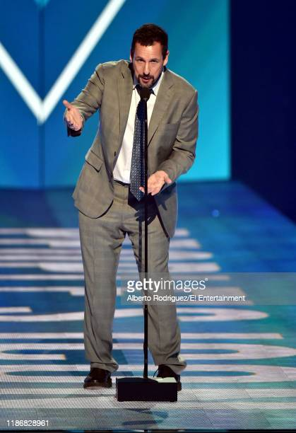 Adam Sandler speaks on stage during the 2019 E People's Choice Awards held at the Barker Hangar on November 10 2019 NUP_188997