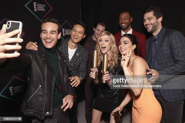 Alberto Rosende Harry Shum Jr Dominic Sherwood Katherine McNamara Emeraude Toubia Isaiah Mustafa and Matthew Daddario snap a selfie with their awards...