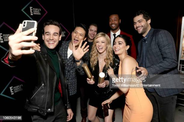 Alberto Rosende Harry Shum Jr Dominic Sherwood Katherine McNamara Isaiah Mustafa Emeraude Toubia and Matthew Daddario snap a selfie with their awards...
