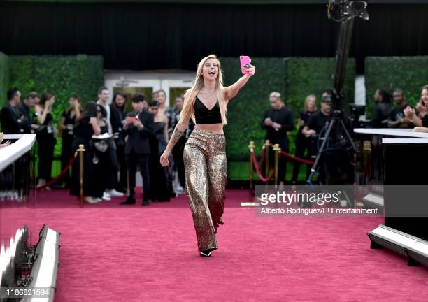 Andie Case arrives to the 2019 E People's Choice Awards held at the Barker Hangar on November 10 2019 NUP_188996