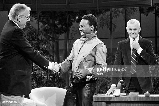 Announcer Ed McMahon actor/comedian Eddie Murphy host Johnny Carson on June 24 1983