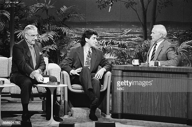 Announcer Ed McMahon and comedian Jeff Cesario during an interview with host Johnny Carson on March 16 1990
