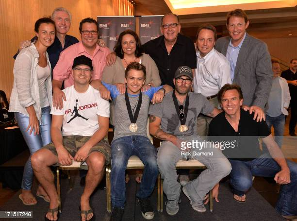 Pictured are cowriter Luke Laird Hunter Hayes cowriter Andrew Dorff and producer Dann Huff Martingale Entertainments Betsy McHugh and Ansel Davis...