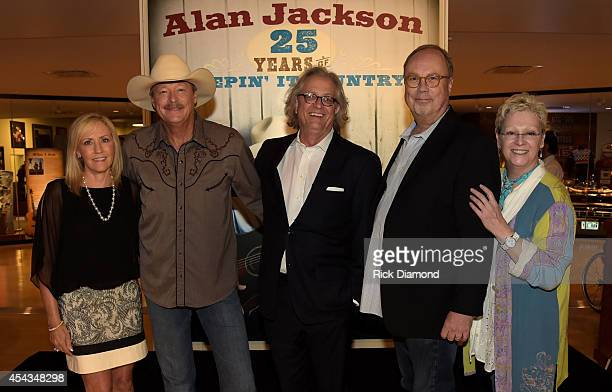 Pictured are Denise Jackson Alan Jackson the Country Music Hall of Fame and Museum's Kyle Young Universal Music Nashville's Mike Dungan and the...