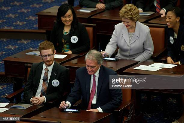Pictured are Edward Markey DMassachusetts and Debbie Stabenow DMichigan who signed tablets in front of them to represent how Senators traditionally...