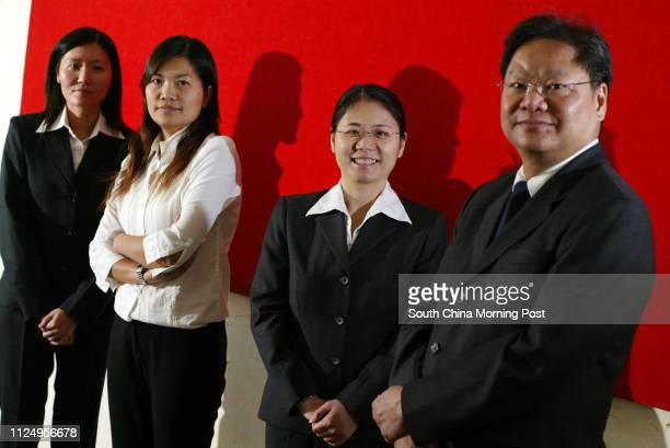 Pictured are four prison wardens Candy Leung Fung Meiyi Poon Poyee and Johnny Man Chikeung in their work uniforms This is for a feature story about...