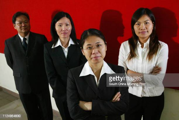 Pictured are four prison wardens Johnny Man Chikeung Candy Leung Poon Poyee and Fung Meiyi in their work uniforms This is for a feature story about...