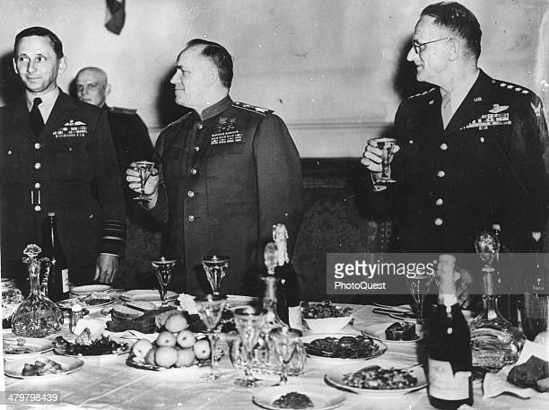 Pictured are from left Air Chief Marshal Sir Arthur Tedder Deputy Supreme Commander Field Marshal Georgy K Zhukov Deputy Commander in Chief of Soviet...