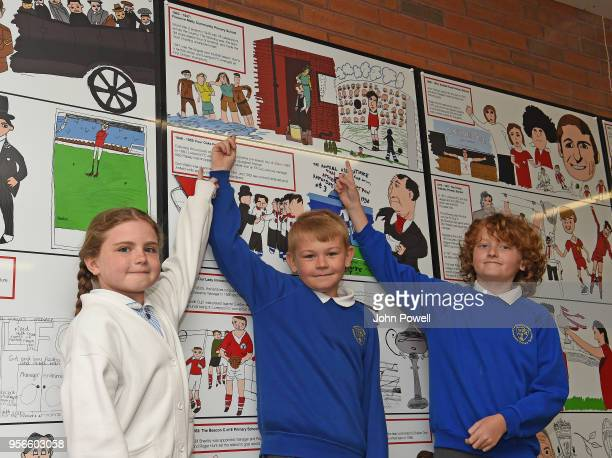Pictured are local school children show off their contribution as part of Liverpool Football Club's 125th anniversary Red Neighbours dotart and...