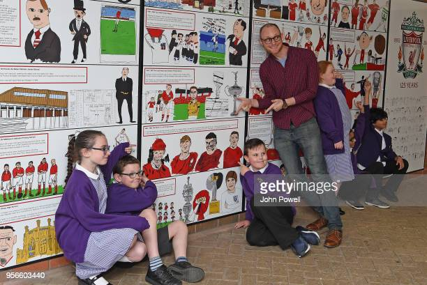 Pictured are local school children with artist David Andrews as part of Liverpool Football Club's 125th anniversary Red Neighbours dotart and artist...